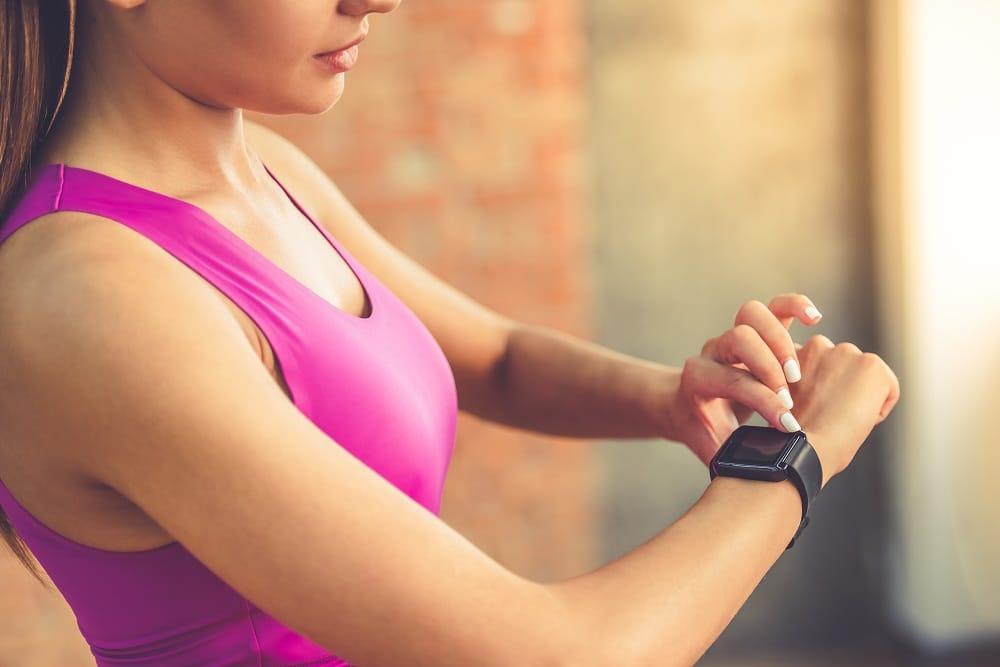 Girl Checks Watch fitness center in phoenix az