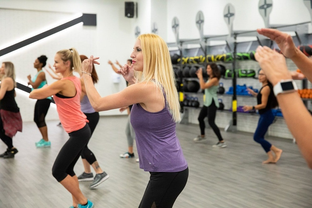Best fitness center in phoenix Group Class Uses Steppers